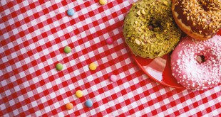 American Donuts on a plate on a nice checkered tablecloth